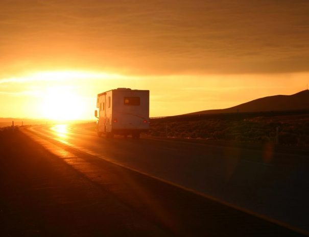 RV On the Road at Sunset